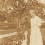 Belle Vivell and family hound dog. Photograph marked August 1917 on back